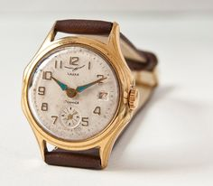 Unisex watch Chaika/Vostok, gold, cocoa tones, Soviet Era. $49.00, via Etsy.