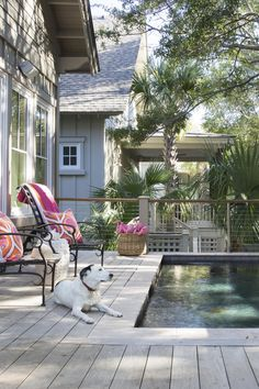Simple chairs with cozy, bright pillows invite guests to linger on this Kiawah Island deck