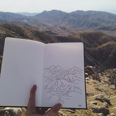 Drawing in the mountains at Joshua Tree National Park with...