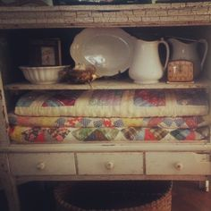 Chippy white paint, ironstone, and old quilts!