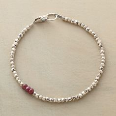 "DIVERSIONS BRACELET -- In a colorful diversion, three rubies interrupt sterling silver beads. Exclusive. Handmade in USA. Lobster clasp. 7-1/4""L."