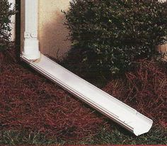 Downspout Extension: Divert rain water away from your house and gardens with this white finished gutter downspout extension.  Unique design allows it to swivel 180 degrees for gardening and mowing the lawn, and easily flips up and out of the way to store flat along the wall when not needed.