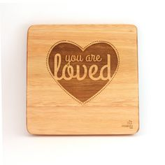"""""""You are loved"""". A simple, creative design but such beautiful words. These can be bought individually or buy the whole set! Wooden Wall Art, Wooden Walls, African Children, Art Wall Kids, Wall Art Designs, Kid Spaces, Nursery Art, Bamboo Cutting Board, Laser Engraving"""