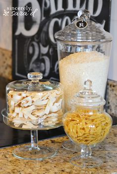 Decorate your kitchen with (inexpensive) glass canisters filled with rice, pasta, oatmeal, marshmallows…whatever!  Looks really cute and is functional, too!