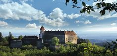 Castle Hotel Bernstein, a truly noble edifice, perched commandingly on a rocky boulder high above the Hungarian lowlands