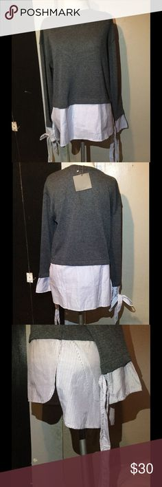 Blouse Sweater. Laced Wrist. Super Comfy. Size S-L Blouse is layered. The back is longer and front is shorter. Very comfy. Sweater blouse is perfect for work or for the house. You can literally go from work to evening drinks. Super chic. I have a small and large. Zara Tops Blouses