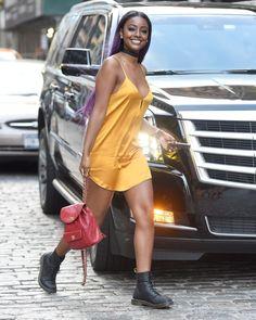 Justine Skye's Gold Slip Dress, Dr. Marten boots