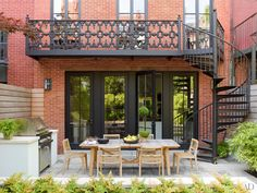 Paneling, cornices, and other details were inspired by 1850s pattern books, while the exterior ironwork was re-created by Pennoyer's firm, whose research uncovered a nearby townhouse by the same builder that still had its original balcony.