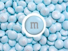 Classic milk chocolate M's candies featured in light blue colored candy shells