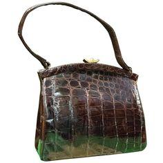 Preowned 1950s Dark Brown Alligator Handbag ($225) ❤ liked on Polyvore featuring bags, handbags, brown, preowned handbags, dark brown bag, brown bag, hand bags and brown handbags