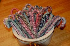 Homespun Wrapped Candy Cane Ornaments    You get 6 plastic candy cane forms for $1…you can't beat it! Simply wrap in homespun. I used hot glue to dab on the ends. Another one of my FAVORITE crafts of all time. This could be done with the large candy canes also found at the dollar store!