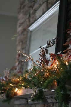Holiday Mantel Decorations Creating Living Room Focal Point: Natural Display Supported By Miniature Wooden Reindeer And Glittery Berry Sprin...