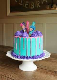 Looking more at the design of this cake and the colors; the characters could be on top like this with cake toppers as shown, too. shimmer and shine cake