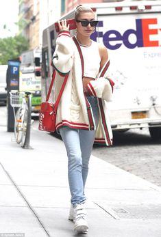 On the move: Letting her Gucci cardigan slide off one shoulder, the 21-year-old niece of A... #HaileyBaldwin #Gucci #Supreme