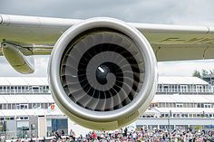 Close up of airbus A380 engine with Farnborough in the background