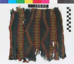 Kelsey Museum of Archaeology, Textiles: Large fragment of a blue, red and yellow sprang cap. Part of the meeting line and closing cord are preserved, as well as small sections of a red braided border.; 0000.01.3532