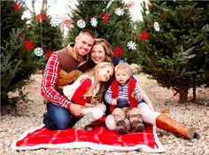 Really cute idea for a family Christmas picture. Tree lot with snowflake banner.
