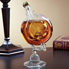 Raise the anchor and set sail with this ship model glass decanter. Whether you fill it with your favorite old-world liquor or display it empty in your office or study, this stunning glass decanter is perfect for history buffs and whiskey lovers alike.