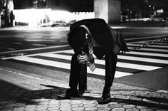 Untitled Street Photography by photographer Michael Nguyen. Makes one wonder what caused this person to get in this pose.