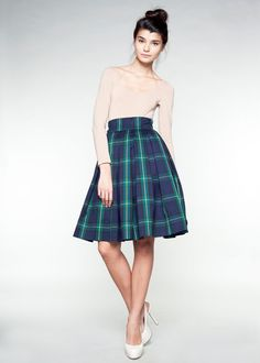Navy blue and green tartan wool skirt.  Cute!