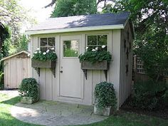 hopefully our potting shed will look like this one day. love the window boxes.