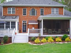A traditional home with a large screened porch #addition and white back deck ©Balducci Builders, Inc.