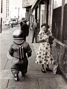 A small spaceman (Eddie Gaedel) roams the Chicago streets before a surprise appearance with three cohorts during a White Sox game at Comiskey Park, 1959.