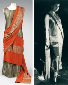 Evening gown, Poiret, ca. 1924. Old gold lamé embossed vertically. Sari-type belt of coral crêpe and lurex thread with frieze-like motifs that wraps around the hips, is thrown over the shoulder, and ends in a train. Beaussant Lefèvre