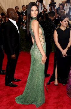 """Best Dressed at Met Gala 2015 """"Minimal Sexy Glam"""": Kendall Jenner in Calvin Klein lace-up side detail full embellished sage green dress at the Metropolitan Museum of Art Costume Institute Gala 2015 """"China: Through the Looking Glass""""."""