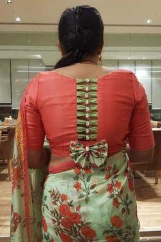 Best 12 Red floral blouse design with tassels detailing and button on back - Simple Blouse Designs, Stylish Blouse Design, Sari Blouse Designs, Designer Blouse Patterns, Designer Dresses, Sleeves Designs For Dresses, Blouse Neck Designs, Latest Blouse Designs, Kurta Neck Design