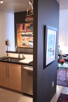 Natural light in the kitchen without showing the mess.  These wall do not acutally join.  There is space where they would otherwise meet and on the other side of the sink to allow light into the kitchen. Series of pics.