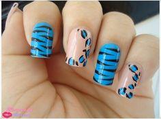 Uñas naranjas y azul de leopardo y cebra.