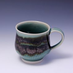 Wheel-thrown Porcelain Mug with Celadon and Tenmoku Glaze and Chattering Decoration By Hsinchuen Lin