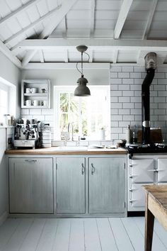 White wash, subway tile, wood counters, sun filled & bright