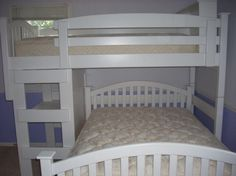 White arched mission full over twin L-shape bunk bed with desk