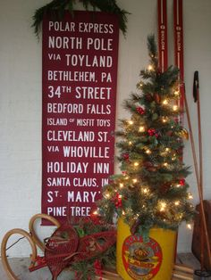 I love this sign! All the great streets/towns from Christmas movies/shows.