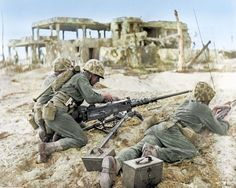 """Three US Marines, one loading an Browning caliber machine gun. 1 February 1944 """"Tempus Fugit but leathernecks keep pace – No time was wasted by these US Marines when they landed on the beach at Namur Island,. Nagasaki, Hiroshima, Iwo Jima, Colorized Photos, War Photography, Us Marine Corps, Us Marines, Military History, Military Humor"""