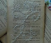 embroidery on old book pages! :)