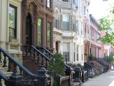 Brooklyn . . . . Landmark 19th-century rowhouses on tree-lined Kent Street in Greenpoint Historic District