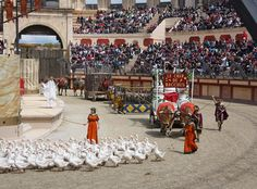 Roman amphitheatre at Puy du Fou in the Vendée with actors in roman costume, roman chariots and live animals.