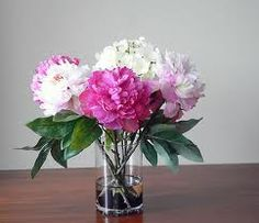 Flower arrangement option 2 - a few small arrangements spread throughout the house in key areas (living room, table, bathroom)