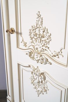 """The door """"Versailles"""" – the personification of exquisite taste, premium door, created in the spirit of French Baroque. Baroque style symbolizes wealth and strength. This model impresses not only with its luxurious appearance, but also with the amount of manual labor that our craftsmen put into the process of its creation. While working in our production workshops, a special atmosphere reigns: each master fulfills the task assigned to him with great dedication and love.  Classic Doors, Baroque Fashion, Wooden Doors, Craftsman, Furniture Design, Strength, Spirit, Windows, Ceiling Lights"""