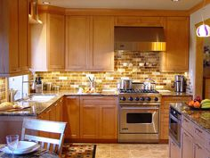 *    Stained glass tile back splash      *         Kitchen design ideas from the experts at Spice Up My Kitchen.   Photo  Howard transitional kitchen