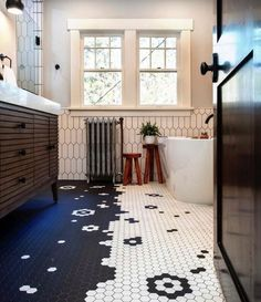 Tile design taken to a whole new level 🖤 This bright and youthful bathroom details a whimsical floor design utilizing porcelain mosaics from #gardenstatetile that were re-mounted to create contrasting elements in the shared space. Design: @designologyluxuryinteriors Photography: @kayleenmichelle Construction: @hugconstruction Floor Design, Tile Design, Bathroom Design Inspiration, Hexagon Tiles, World Of Interiors, Honeycomb, Design Projects, Kids Rugs, Flooring