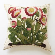 "Hand needlepointed luxury pillow feat. Botanical Daisy and bee on cream ground. Design stitched in 100% wool. Moire style backing fabric. Measures 16"" x 16""."