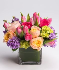 Pastel Garden This low & lush collection of pastel pinks, lavenders, yellows and greens - including tulips, garden roses, and stock - is designed in our signature leaf-lined cube vase