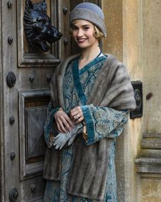 Lily James adorned in an original Fortuny cloak for the final season of downton abbey