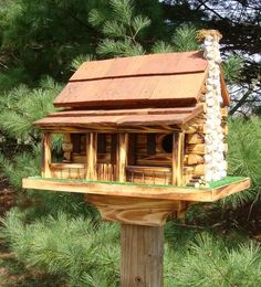log cabin birdhouse. Could be a little library?