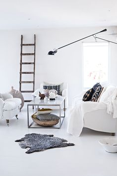 #interior #decor #styling #livingroom #lounge #white #scandinavian #cushion #ladder #lamp #sheepskin #natural