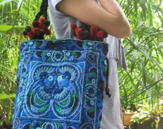 This bag is vintage style and home to north Thailand Hmong tribal people. The bag is in new condition. The measurements are 14 inches wide by 9.5 inches high.  Please note that the stated width of the bag measures the bottom (the widest part) of the bag not the top.  Please also note that all of our bags are lined with soft black cotton and have a zip to open/close as well as a inside zip pocket.   If you have any further questions regarding this order or a multiple order please feel fre...